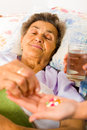 Supplements for seniors in nurse s hands weak senior woman Stock Image