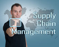 Supply chain management young man press digital button on interface in front of him Royalty Free Stock Images