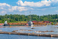 Supply of timber to riverfront papermill Royalty Free Stock Photo