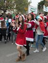 Support group members dressed as Santa Claus entertain participants and visitors of the annual race `Cristmas Run` in Mi`ilya in I Royalty Free Stock Photo