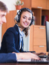 Support team working in call centre smiling employees of customer Stock Images