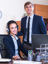 Support team working in call centre smiling operators of customer focus on woman Stock Photo