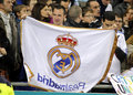 Supporter of real madrid holds up a flag during a spanish league match between espanyol and at the estadi cornella on Royalty Free Stock Photo