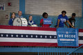Supporters of president obama stand at railing with sign saying we decide at campaign rally at orr middle school Royalty Free Stock Images