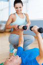 Supporting in every move confident female physical therapist senior men weight exercises Royalty Free Stock Photos