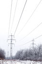 Supports high voltage power lines in winter Royalty Free Stock Image