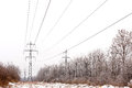 Supports high voltage power lines winter in Stock Images