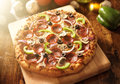 Supreme italian pizza with pepperoni and toppings photo of a Royalty Free Stock Photography