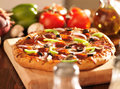 Supreme italian pizza with pepperoni and toppings photo of a shot selective focus Stock Image