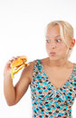 Suprised girl eating burger Royalty Free Stock Image