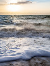 Surf at Dead Sea in winter dusk Royalty Free Stock Photo