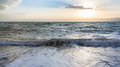 Surf at Dead Sea in winter sunset Royalty Free Stock Photo