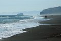 Surf people sand very big beach pacific ocean east coast of peninsula kamchatcka Stock Photo