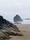 Surf rolling in on a rocky beach the the oregon coast usa Stock Photo