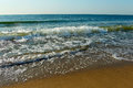 Surf on the shore of the Black Sea in sunny day Royalty Free Stock Photos