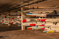 Surf skis canoe racing crafts holding racks dozens of water placed or stacked in at marine life saving club in durban south Stock Images