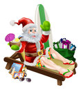 Surf summer santa christmas claus relaxing on the beach or by the pool wearing bermuda or hawaiian board shorts and flip flop Royalty Free Stock Image