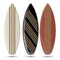 Surf three colored surfboards with different styles and patterns Royalty Free Stock Photos