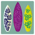 Surf three different surfboards with different colors and styles Royalty Free Stock Image