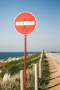 Surf zone a street sign victim of street art in a very known in portugal baleal peniche Royalty Free Stock Photo