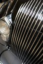 Surface grille and headlights of vintage retro car Royalty Free Stock Photo