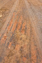 Surface of ground at the road wheels and tracks. Royalty Free Stock Photography