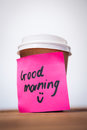 Surface level of good morning text stuck on disposable cup Royalty Free Stock Photo