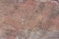 Surface of natural dark red stone as background crimson quartzite porphyry Stock Images