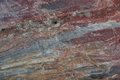Surface of natural dark red stone as background crimson quartzite porphyry Royalty Free Stock Photography