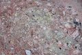Surface of natural stone as background dark red crimson quartzite porphyry Stock Images