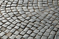Surface of the old paving road is paved with stone setts Royalty Free Stock Image