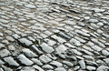Surface of the old paving road is paved with stone setts Royalty Free Stock Photos