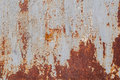 Surface of rusty iron with remnants of old paint, grey texture, background Royalty Free Stock Photo