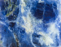 Surface of Sodalite natural mineral gem stone Royalty Free Stock Photo