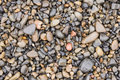 Surface texture of wet sea beach pebbles of medium and small size Royalty Free Stock Photo