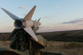 Surface to surface missile on a launcher mounted in defensive position overlooking open countryside Royalty Free Stock Photography