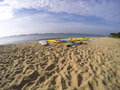 Surfboard on the sandy beach with cloudy sky Royalty Free Stock Photos
