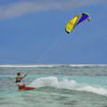 Surfer, colorful kite Stock Images