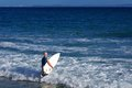 Surfer Entering The Ocean With...