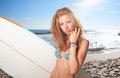 Surfer girl on a beach Royalty Free Stock Image