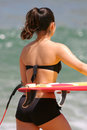 Surfer Girl in Bikini Going Surfing Royalty Free Stock Photo