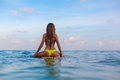Surfer girl on surfboard have a fun before surfing Royalty Free Stock Photo