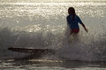 Surfer girl surfing contest in early morning light a wave the during the east coast wahine Stock Photo