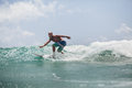 Surfer man surfing on waves splash actively vacations Royalty Free Stock Images