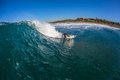 Surfer riding hollow wave water photo of young african turning off the bottom on a clear blue fun along the south coast of durban Royalty Free Stock Photography