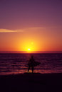 Surfer and sunset Royalty Free Stock Photos