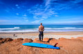 A surfer at a surf break in morocco studying near the fishing village of taghazoute Stock Images