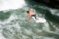 Surfer unidentified in the eisbach river in munich germany Royalty Free Stock Image