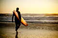 Surfer walking Royalty Free Stock Photo