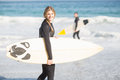 Surfer walking on the beach with a surfboard Royalty Free Stock Photo